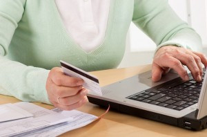 Self-service transaction at home on laptop with credit card