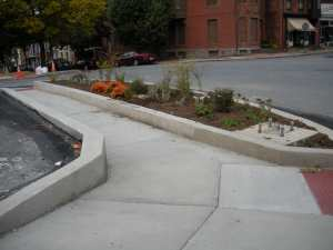 ADA curbed sidewalk with open ramps for street access